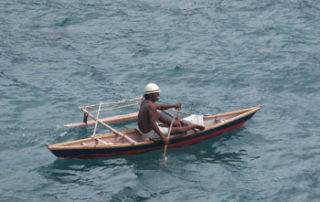 outrigger canoe fisherman